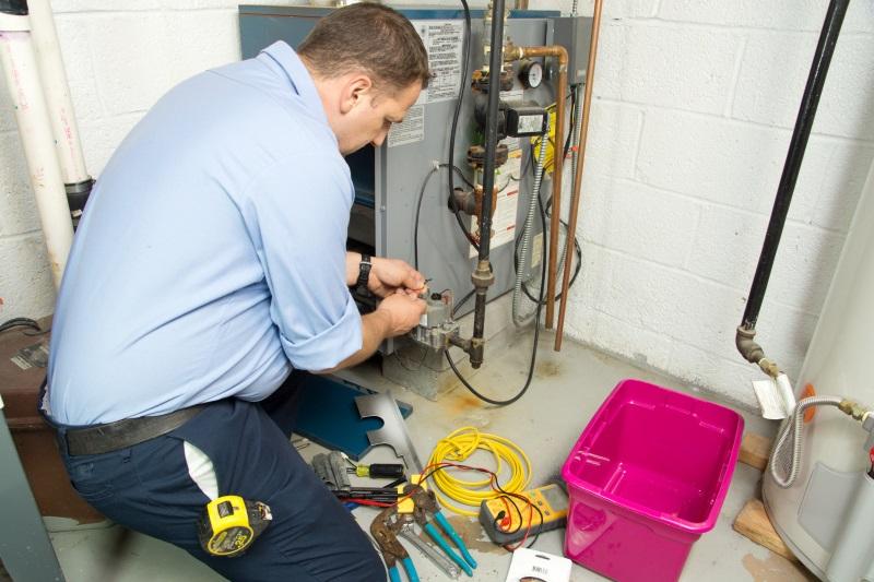 bigstock-Plumber-fixing-gas-furnace-40351003 (1)