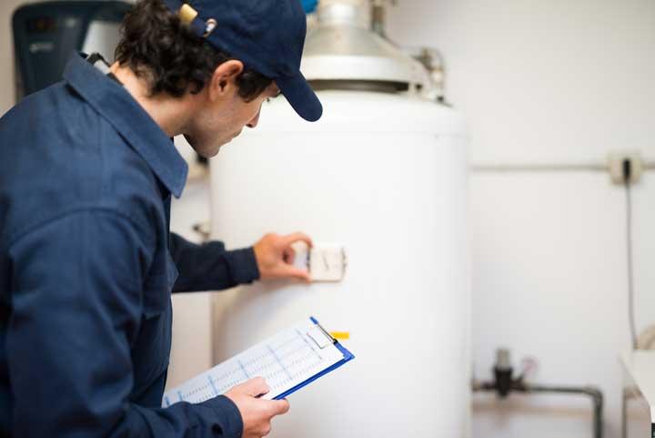 Plumbing Contractor Doing Water Heater Installation